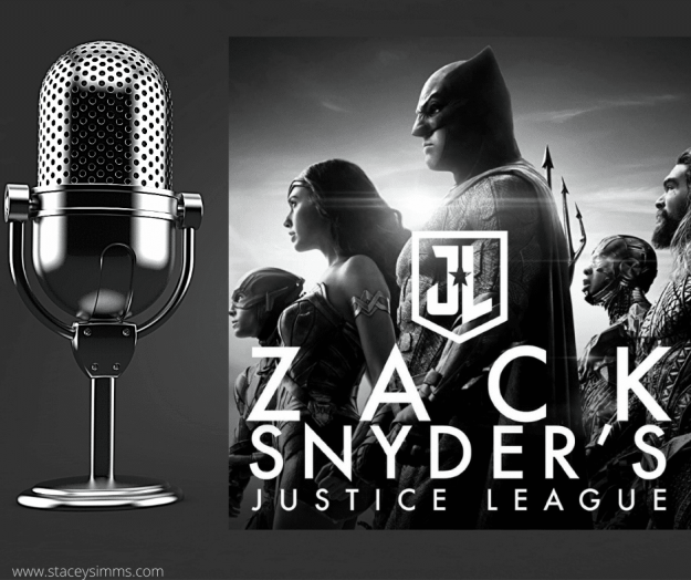Microphone next to HBO Justice League logo
